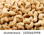 fried cashews as a texture. | Shutterstock . vector #1050663998