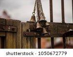 bells on door gate garden close ... | Shutterstock . vector #1050672779
