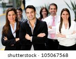 Successful business group looking confident and smiling - stock photo