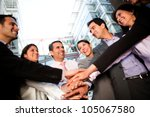 Successful business team bonding and working together - stock photo