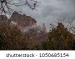 clouds and fog over red rock... | Shutterstock . vector #1050685154