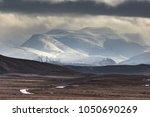 snowstorm over the cairngorm... | Shutterstock . vector #1050690269