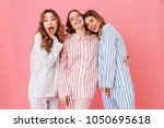 portrait of three beautiful... | Shutterstock . vector #1050695618