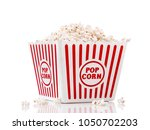 red and white popcorn box... | Shutterstock . vector #1050702203