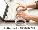 laptop  in the office | Shutterstock . vector #1050707243