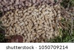 Small photo of Wooden pellets of different sizes green pellet pure pellet animal food bedding
