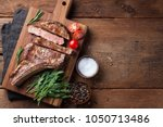 grilled cowboy beef steak ... | Shutterstock . vector #1050713486