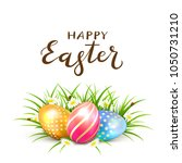 three colorful easter eggs in... | Shutterstock .eps vector #1050731210