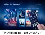 vod service screen with remote... | Shutterstock . vector #1050736439