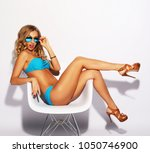 blond woman with long hair in... | Shutterstock . vector #1050746900