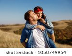 happy young couple enjoys a... | Shutterstock . vector #1050749954