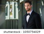 sharply dressed groom in black...   Shutterstock . vector #1050756029