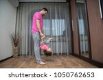father and his son do acrobatic ...   Shutterstock . vector #1050762653