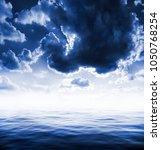 ocean and clouds. fantastic... | Shutterstock . vector #1050768254