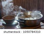 hot pot boiler with water... | Shutterstock . vector #1050784310