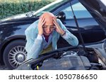 Small photo of Broken car. Closeup portrait young stressed man having trouble with his broken car looking in frustration at failed engine