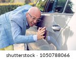 perfectionist and his car.... | Shutterstock . vector #1050788066