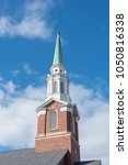 church steeple with cross and...