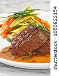 Small photo of filet au poivre vert with vegetables