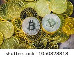 many bitcoins laying all over... | Shutterstock . vector #1050828818