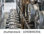 various alloy wheels in store ... | Shutterstock . vector #1050840356