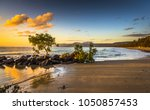 colourful sunrise 4 mile beach tropical Port Douglas Coral sea clear calm ocean morning north queensland