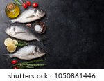 raw dorado fish with spices... | Shutterstock . vector #1050861446