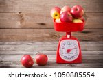 apples on red scales | Shutterstock . vector #1050885554