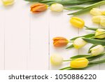 yellow tulips on wooden... | Shutterstock . vector #1050886220