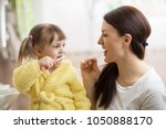 mom teaching daughter child... | Shutterstock . vector #1050888170