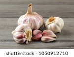 garlic bulbs  with some purple... | Shutterstock . vector #1050912710