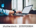 cropped image of hand searching ... | Shutterstock . vector #1050930884
