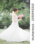 portrait of stunning bride with ... | Shutterstock . vector #1050943310