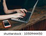 young pretty brunette woman eat ... | Shutterstock . vector #1050944450