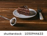 a piece of chocolate cake on a...   Shutterstock . vector #1050944633