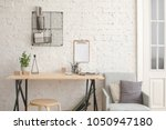 desk with stationery in the... | Shutterstock . vector #1050947180