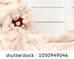 small knitted baby toy bear is... | Shutterstock . vector #1050949046