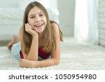 girl with braces | Shutterstock . vector #1050954980