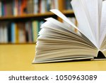 opened book on table | Shutterstock . vector #1050963089