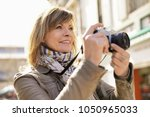 Mature Woman Photographer...