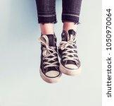 woman wear black sneaker shoes | Shutterstock . vector #1050970064