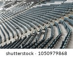 empty old plastic chairs in the ... | Shutterstock . vector #1050979868