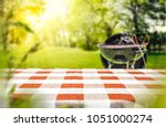 red and white tableclothe in... | Shutterstock . vector #1051000274