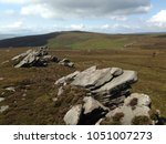 Small photo of Bleak moors and hills in the Yorkshire Dales with rock formations and clouds