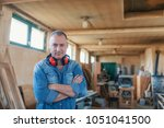 portrait of a man who owns a... | Shutterstock . vector #1051041500