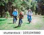 little boy with grandparents... | Shutterstock . vector #1051045880