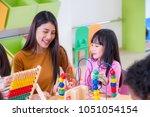 asian female teacher teaching... | Shutterstock . vector #1051054154
