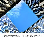 three buildings forming a... | Shutterstock . vector #1051074974
