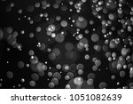 black bokeh  abstract black... | Shutterstock . vector #1051082639