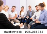 group of cheerful students at... | Shutterstock . vector #1051085753
